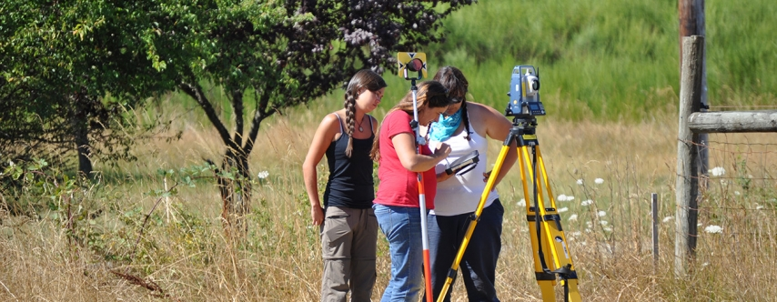 field school students with survey equipment