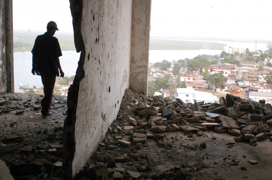 A figure stands in the ruined E.J. Roye Building in Monrovia, Liberia, in 2012. All photos courtesy Danny Hoffman.