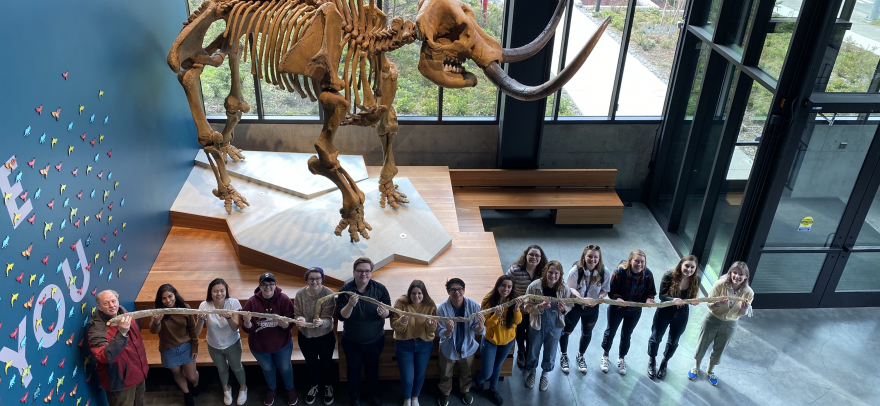 Ethnoarchaeology students holding up the inflated processed bear intestine. 2020.