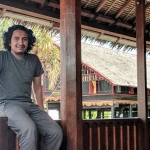 Dimas Romadhon sitting on a railing in Aceh Indonesia