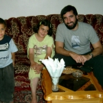 Michael Pèrez with two children in Baqa'a Refugee Camp, Amman