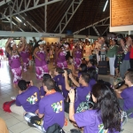 UW students (in purple T-shirts) being welcomed by dancers at the airport in Huahine