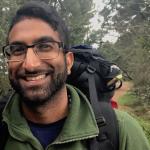 Sam in hiking gear smiling