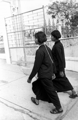 Photo of two women walking down a street