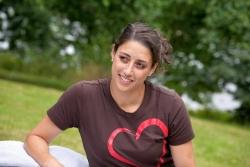 Faustine Dufka, wearing a Soulumination T-shirt