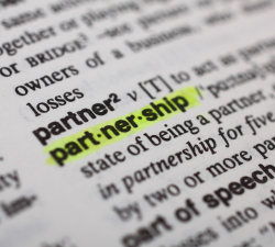 photo of dictionary page showing definition of 'partnership'