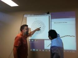 Dr. Goodreau showing data charts