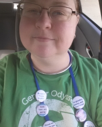 Baya Walls, wearing a Gender Odyssey T-Shirt with Transgender Activist Buttons