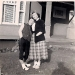 1950's photo of two women in front of a house, with faces blurred