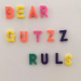 """Bear Gutzz Rule"" written in fridge magnets"